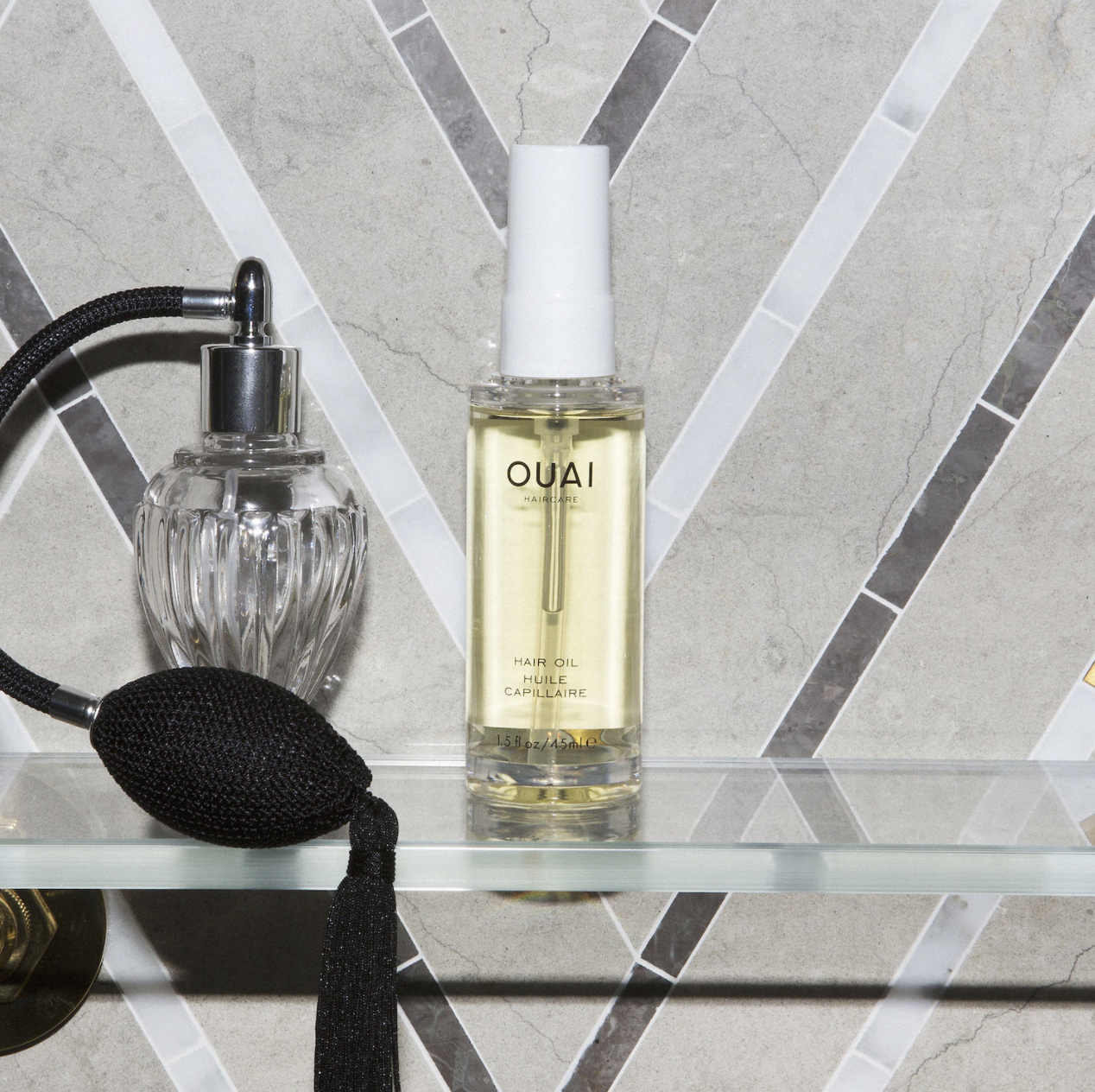 A bottle of the hair oil on a flat surface