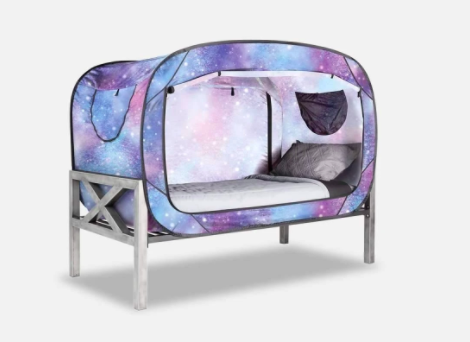 privacy pop tent around a bed with frame