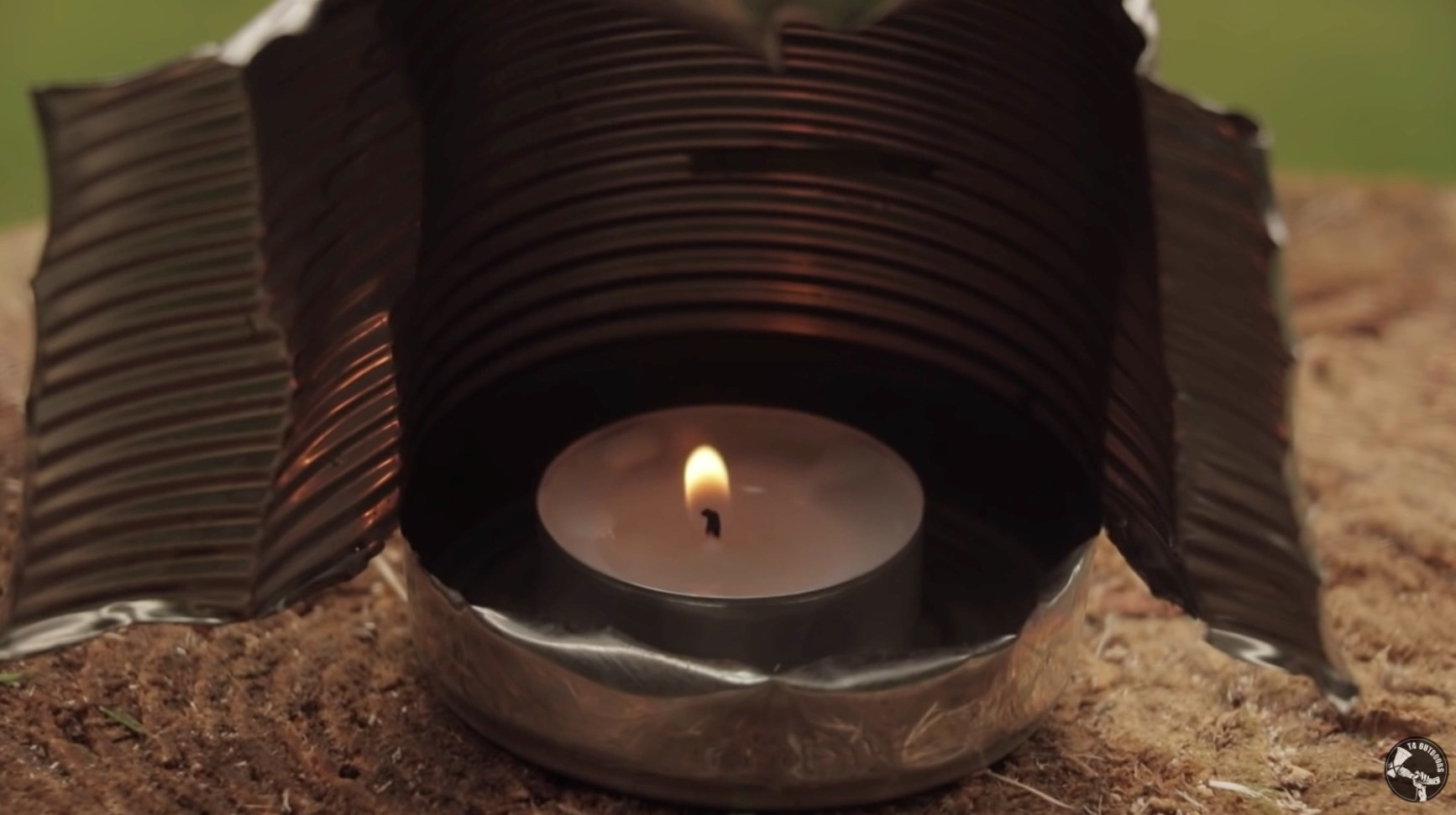 Candle holder made out of a can