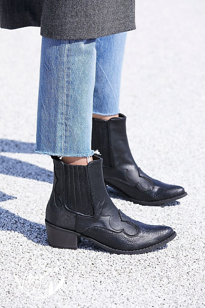 Black cowboy boots that end right above the ankle