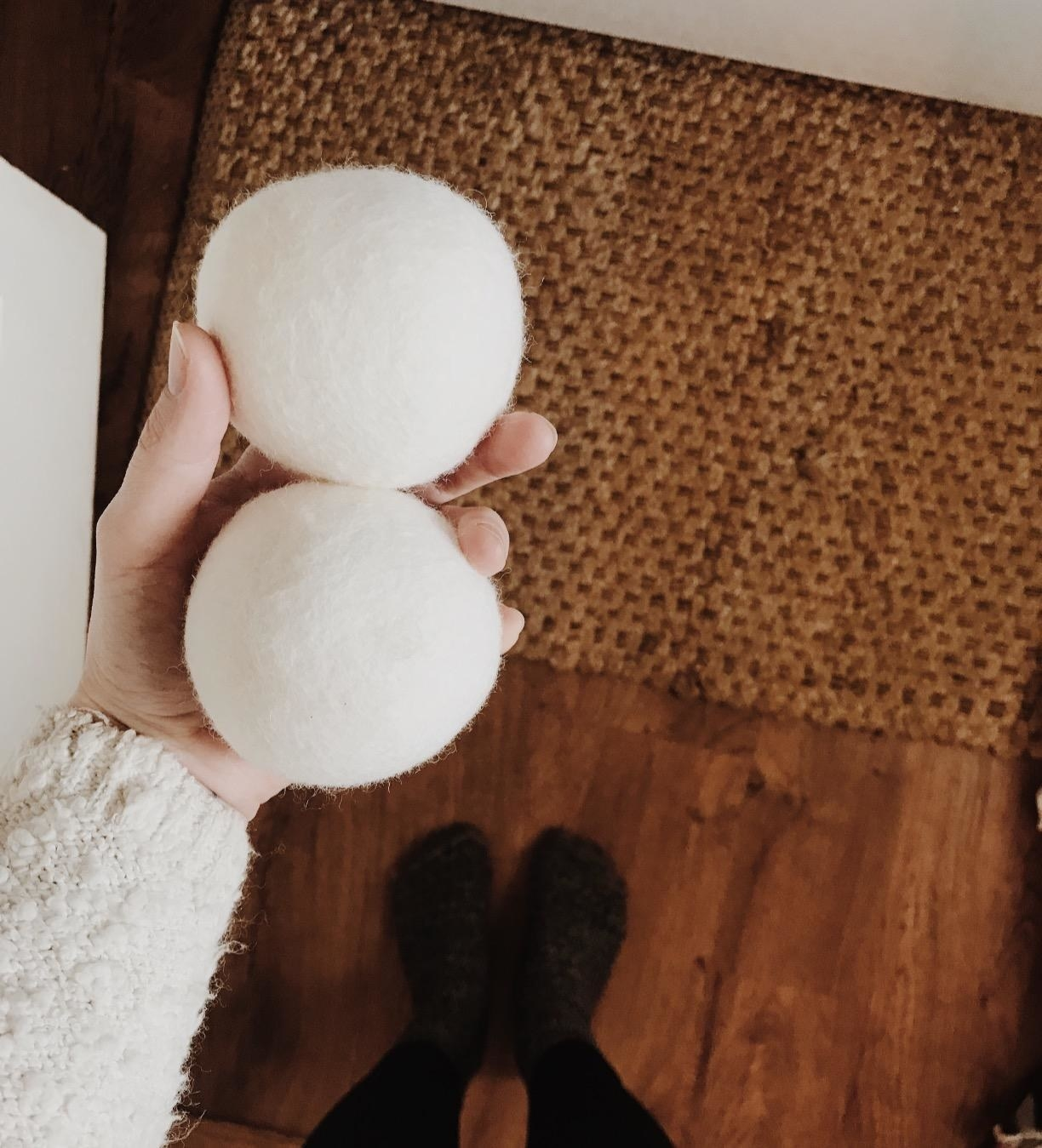 Reviewer holding two of the white balls in their hand