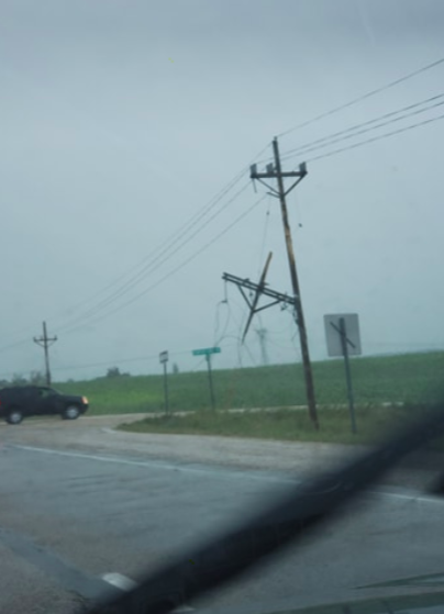 An electrical pole hanging off of a wire