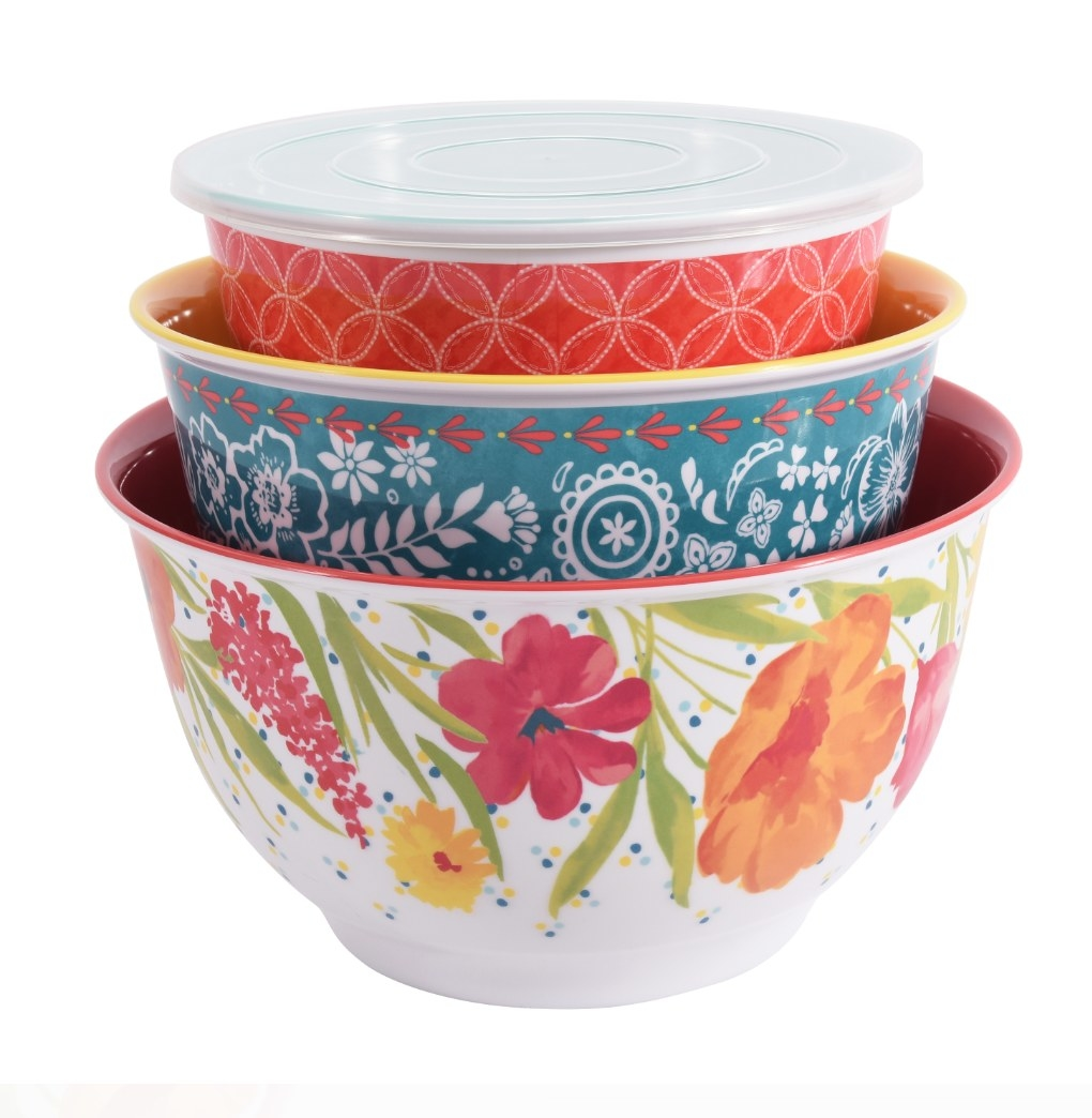 Three colorful melamine bowls stacked inside of each other