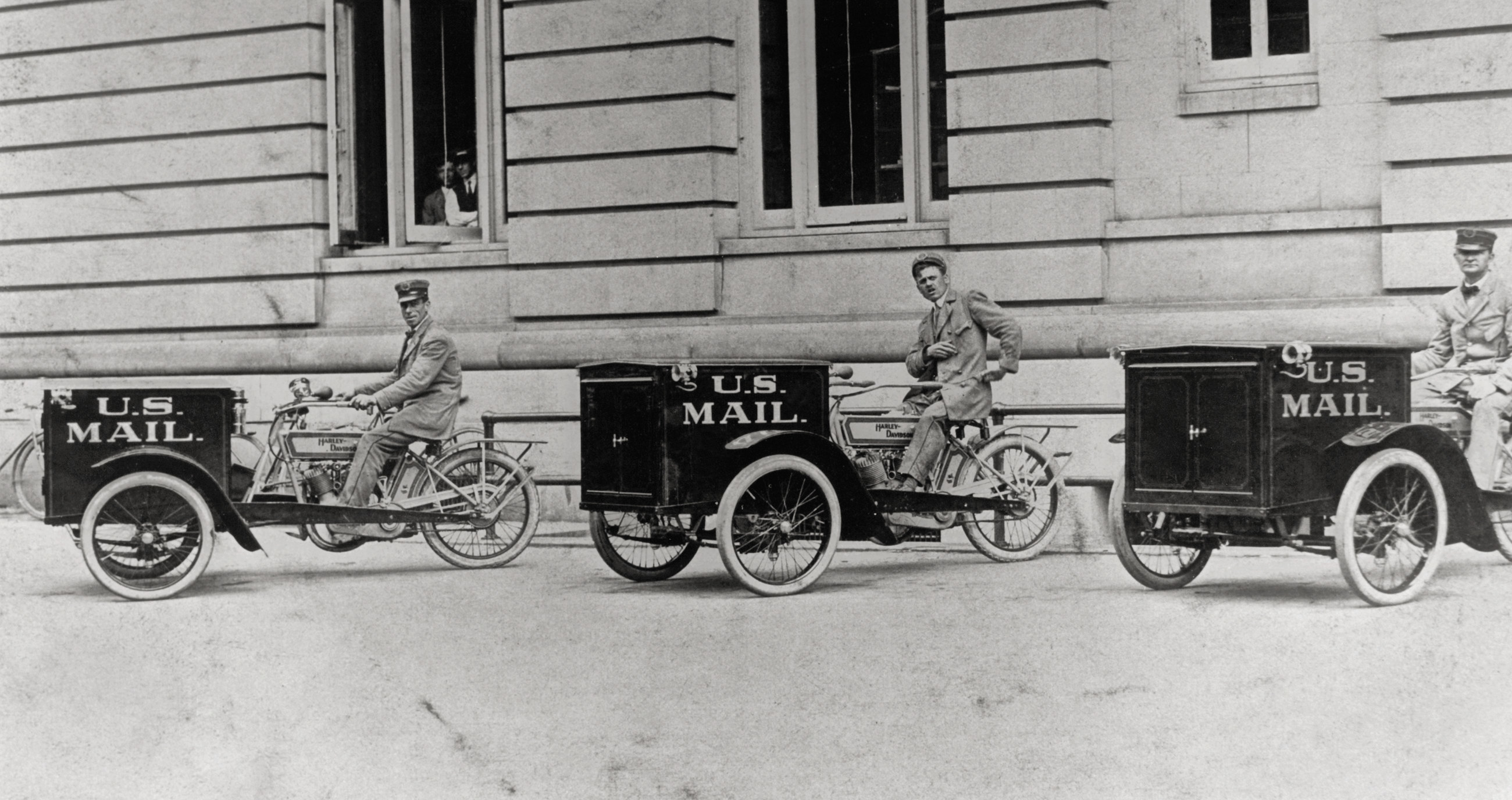 Three men on small motorcars that say US mail