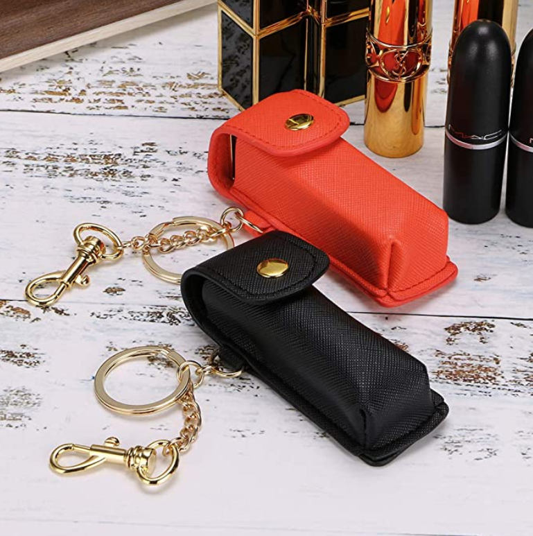 To small leather pouches with a key chain attached to the side