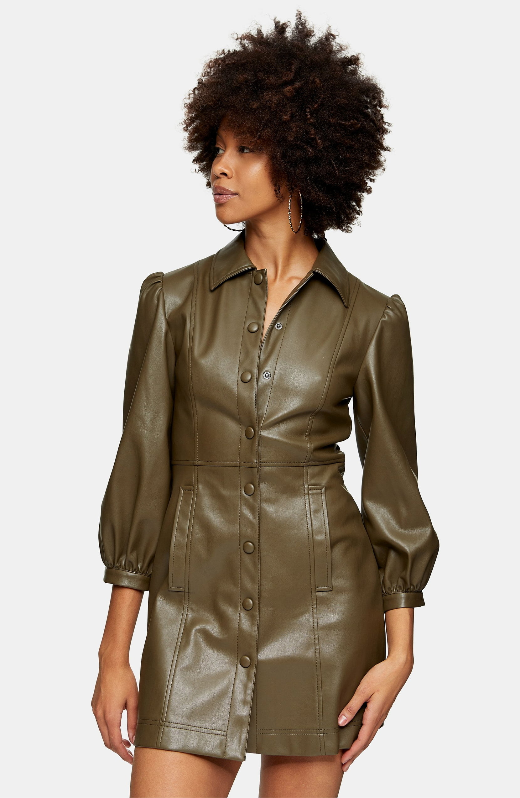A model wearing the Topshop Long Sleeve Faux Leather Shirtdress.