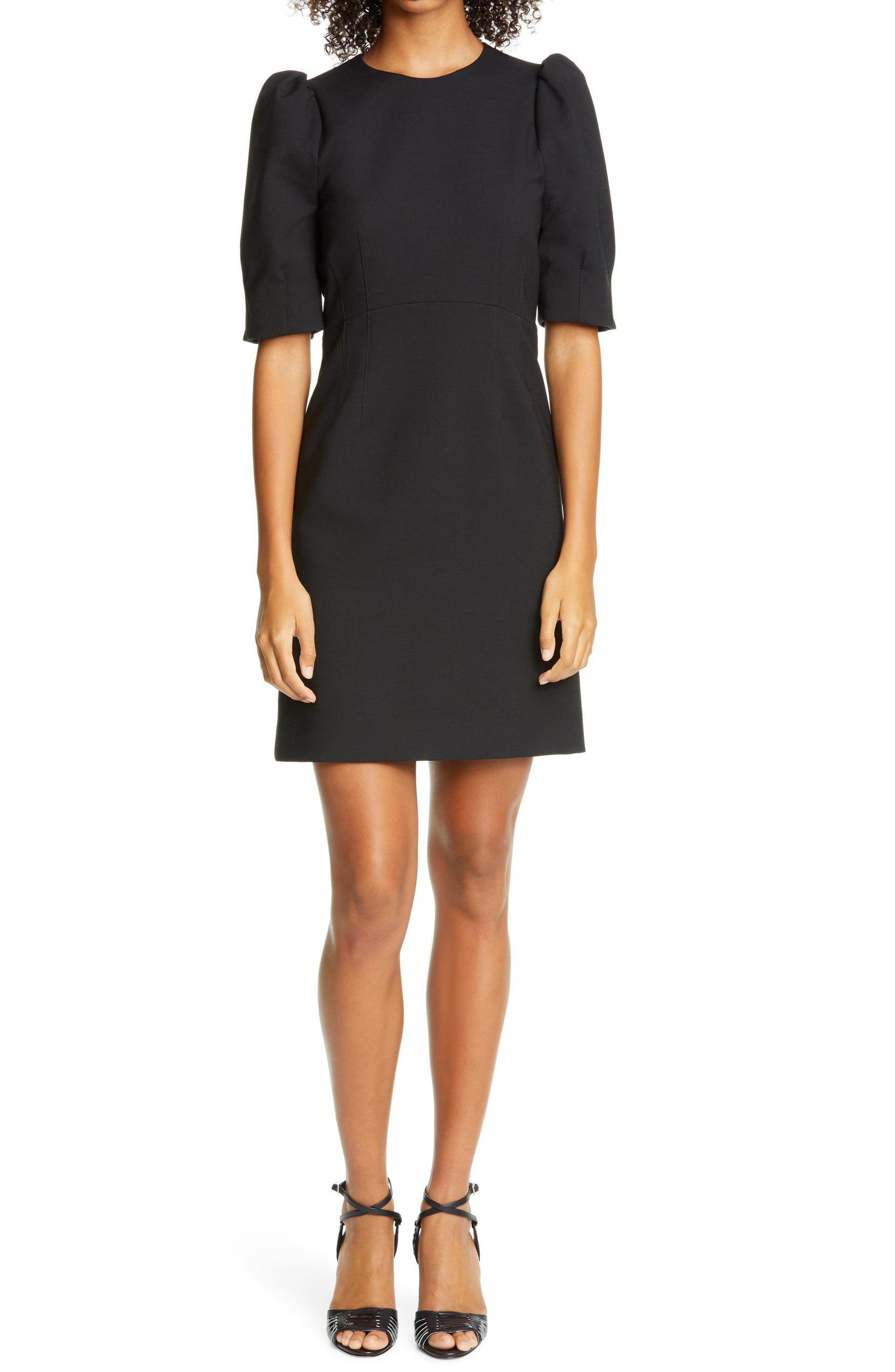 A model wearing the Veronica Beard Meadow Puff Sleeve Minidress.