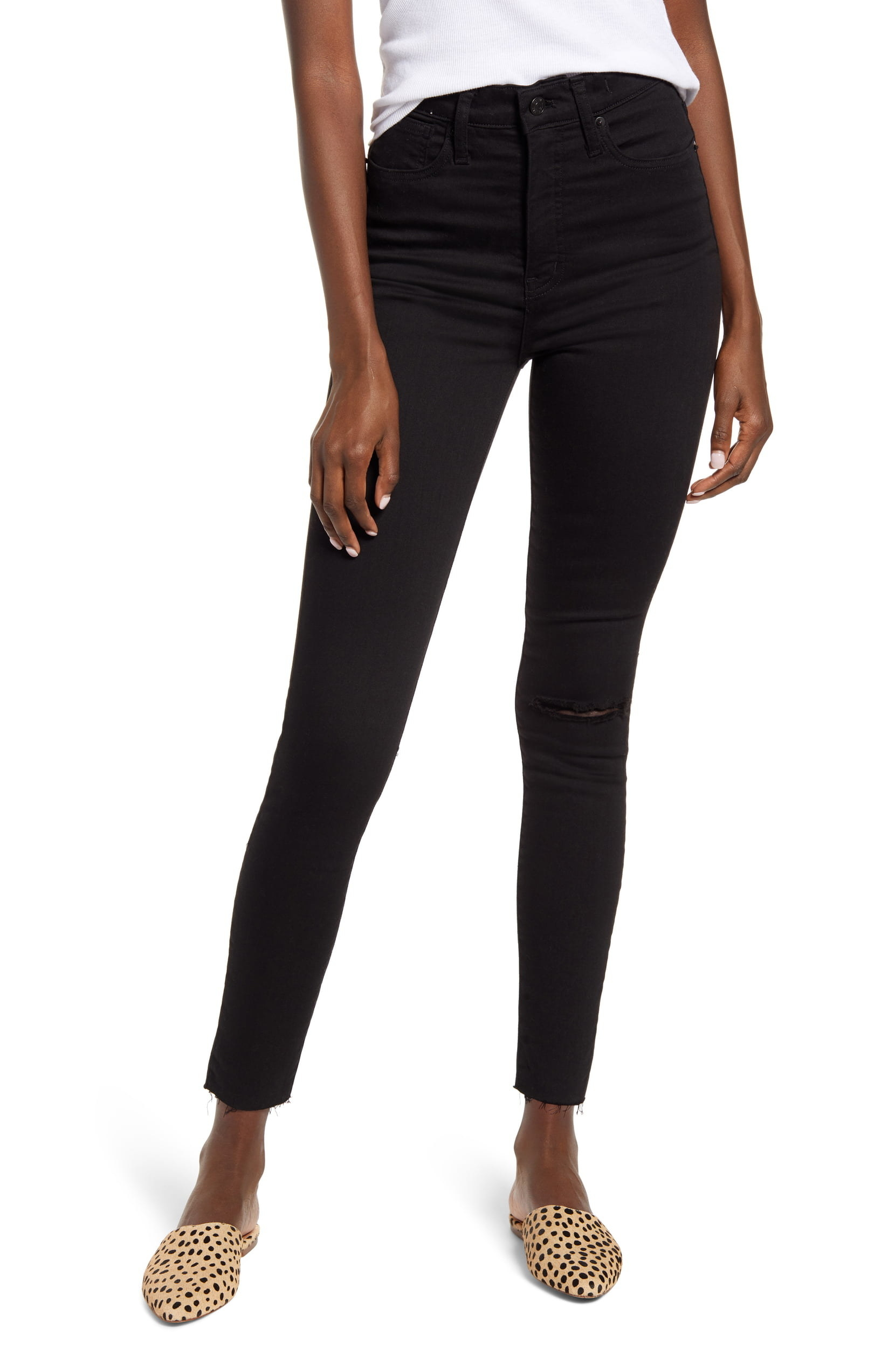 A model wearing the Madewell 11-Inch High-Rise Skinny Jeans.