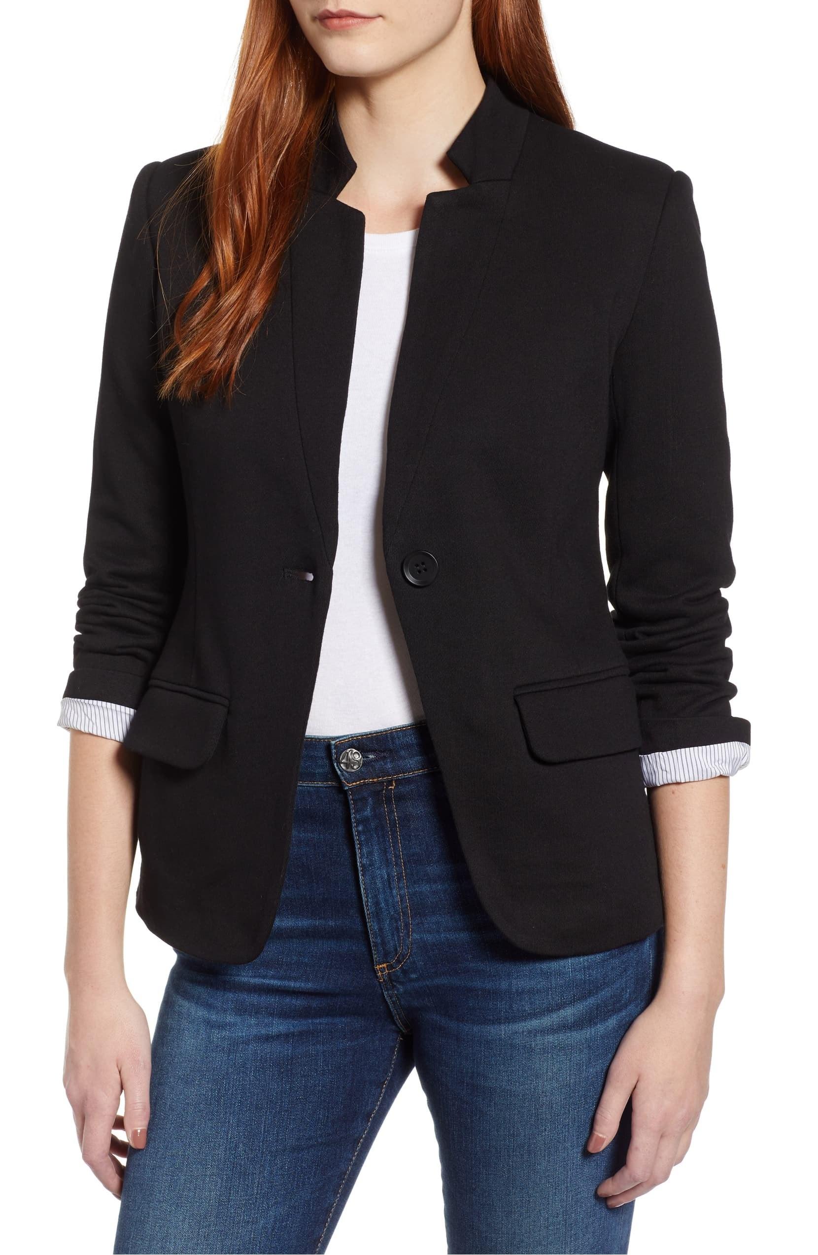 A model wearing the Gibson Notch Collar Cotton Blend Blazer in black.
