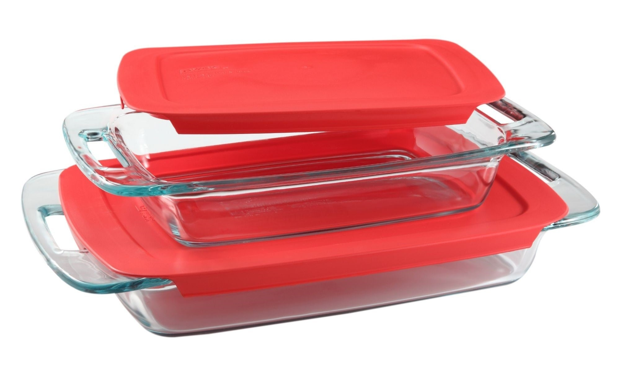 Two glass Pyrex dishes with red lids stacked on top of each other