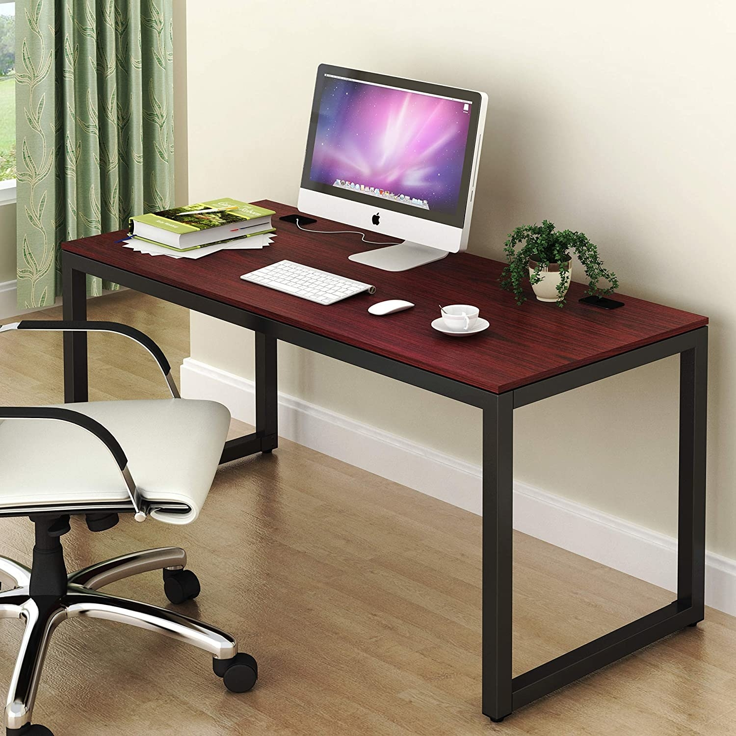 Cherry wood-like top desk with black legs with a computer on top of it