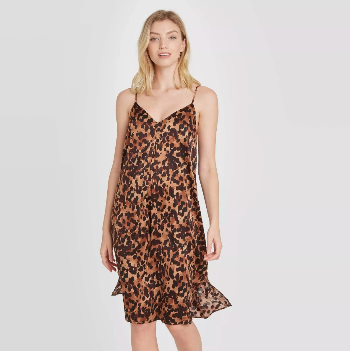 Model wearing the tortoise-print satin nightgown