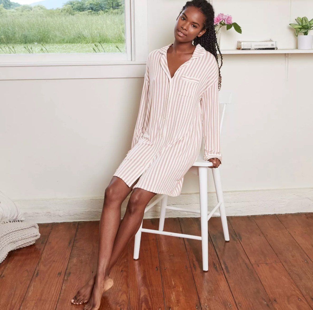 Model in the pink and white striped sleep dress
