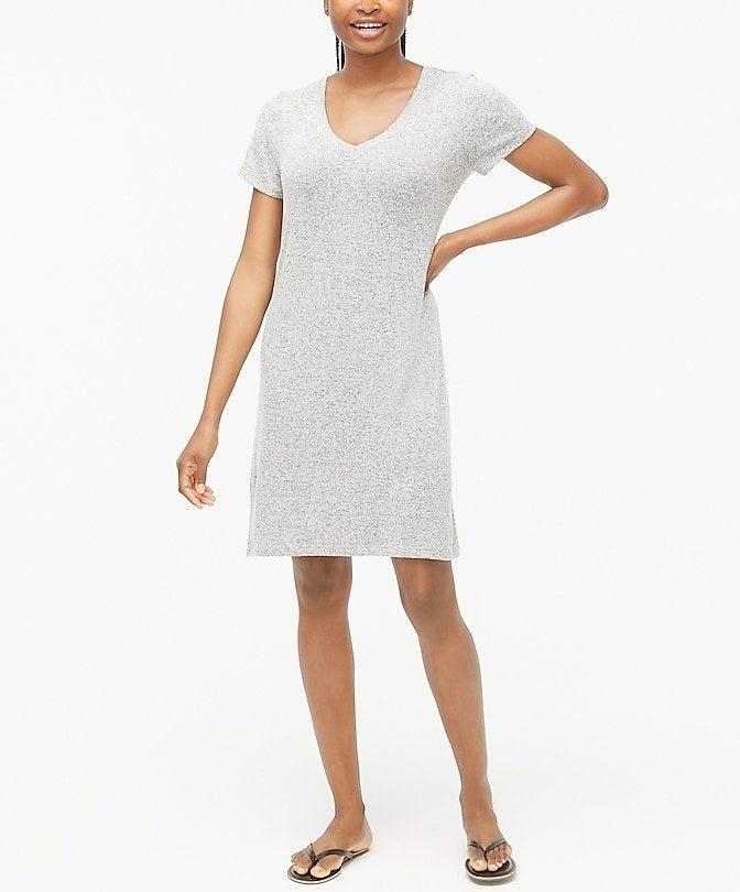 model in a light grey knee-length V-neck T-shirt dress