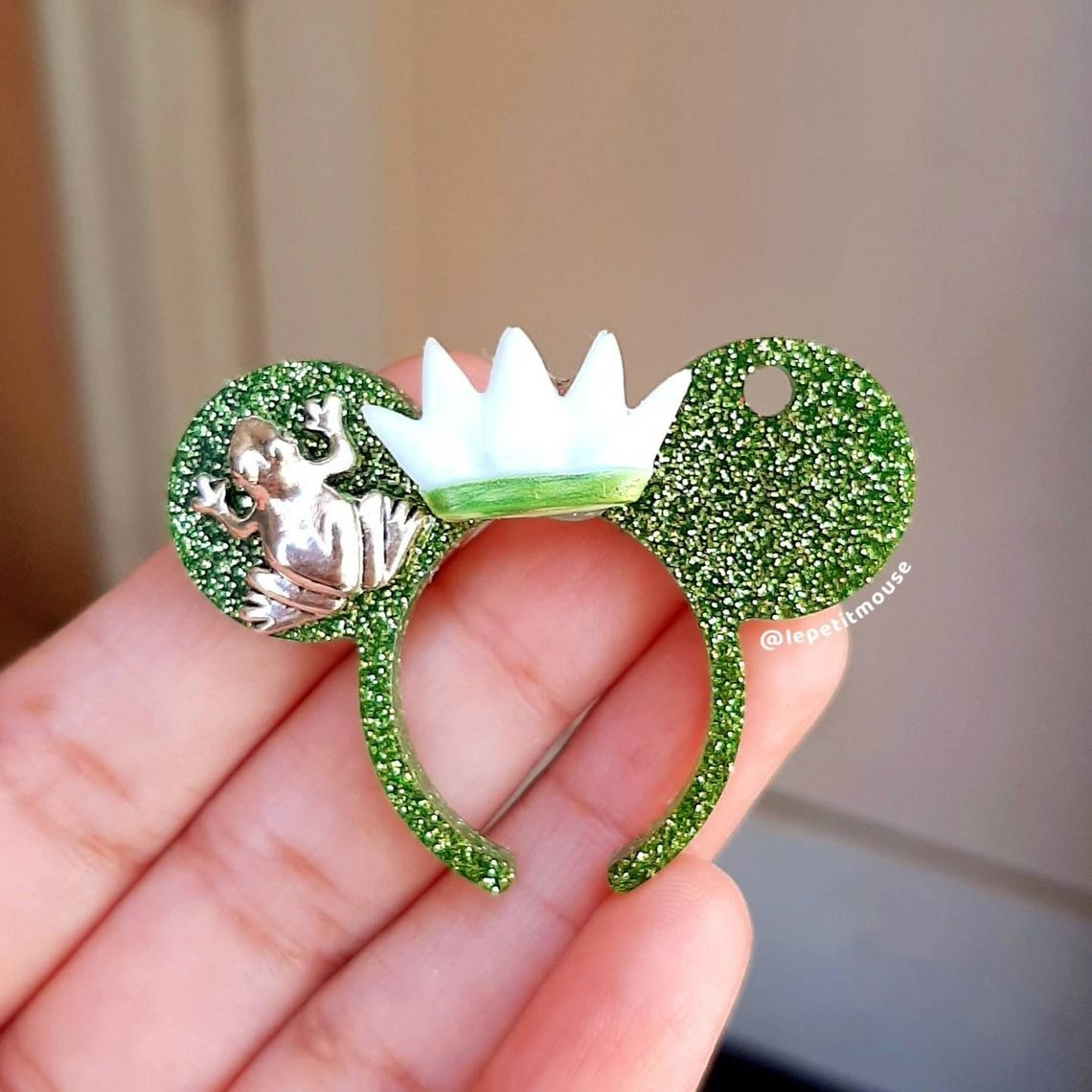 glittery mouse ears with white crown and frog on one ear
