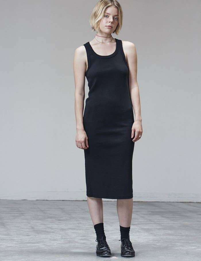 Model wearing midi-length tank dress in black