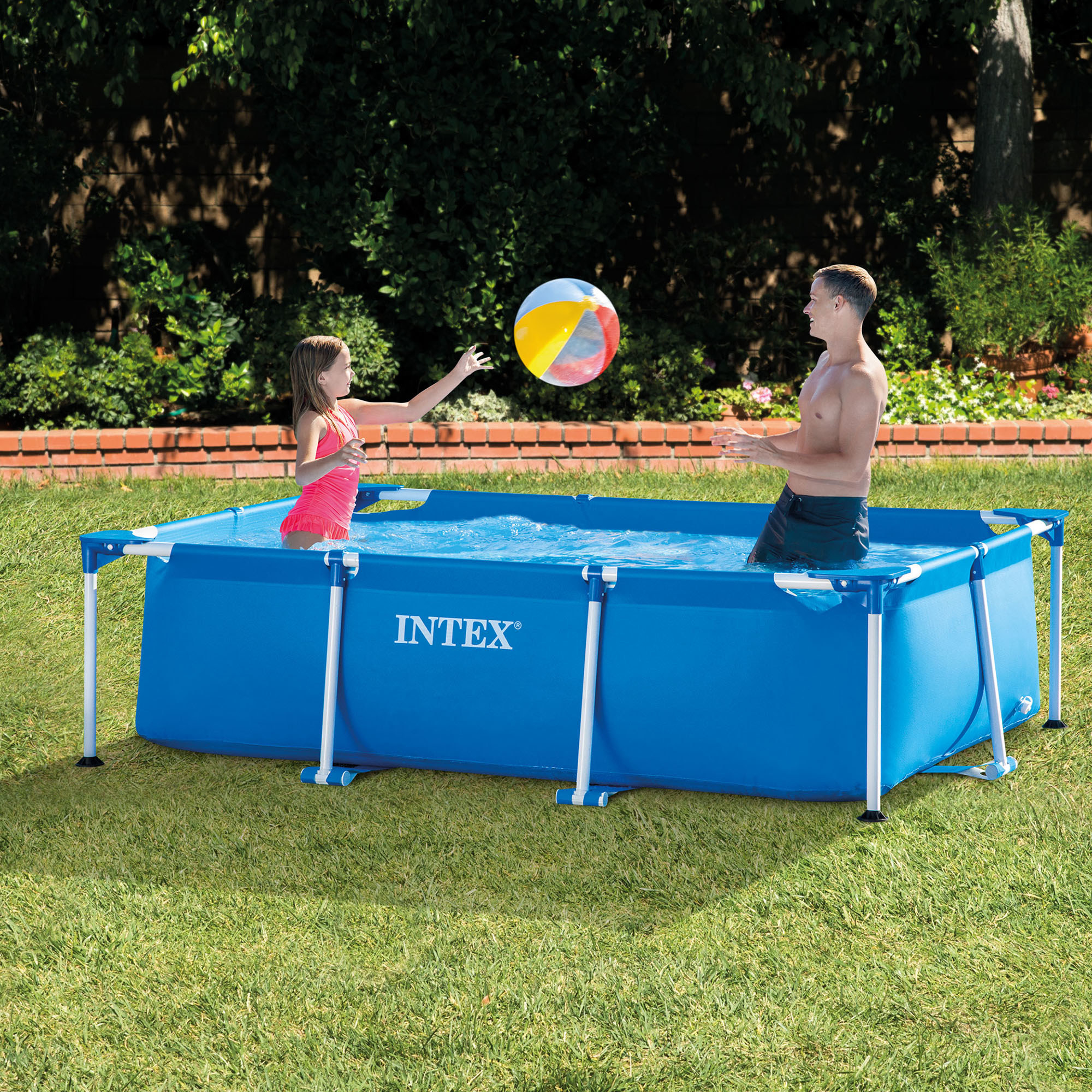 Two people play in the Intex Rectangular Frame Above Ground Swimming Pool