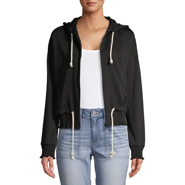 The zip-up hoodie with ruffled sleeve cuffs and hem