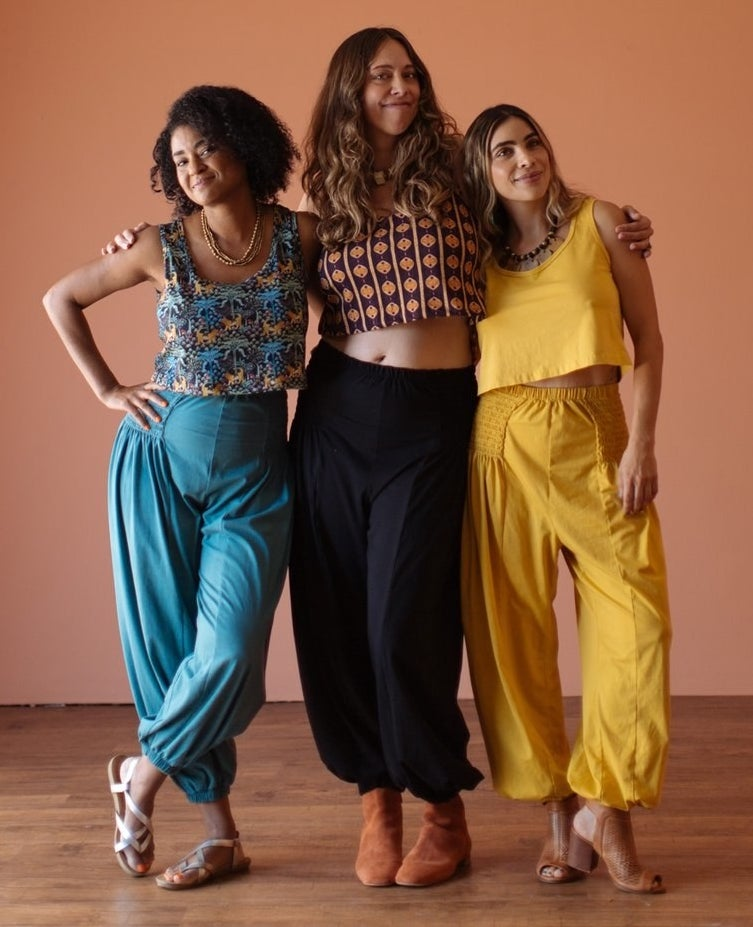 three models in solid teal, black, and yellow long balloon-pants