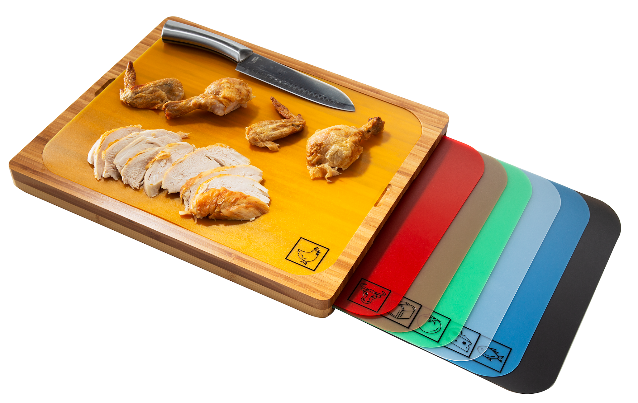 Product photo showing bamboo cutting board with 7 color-coded cutting mats, with the poultry mat being used on the bamboo cutting board to slice chicken