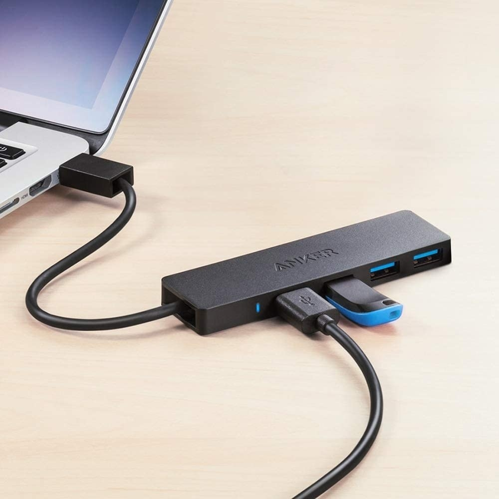 The USB hub plugged into a laptop with two USB cables attached to it