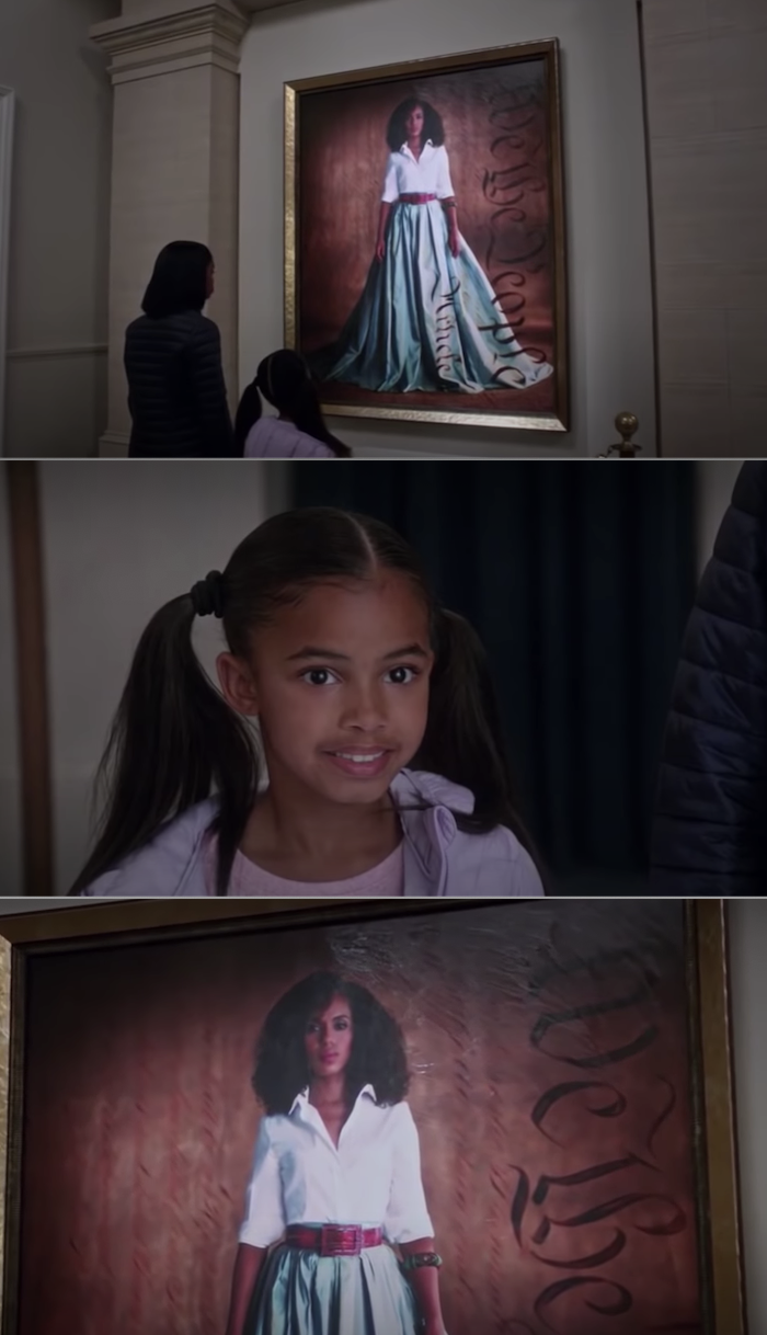 Two Black girls smile as they look at Olivia Pope's portrait hanging in the gallery