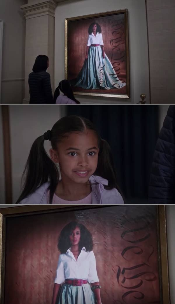 4. Two little girls gazed at Olivia Pope's portrait in the gallery with admiration and hope in Scandal.