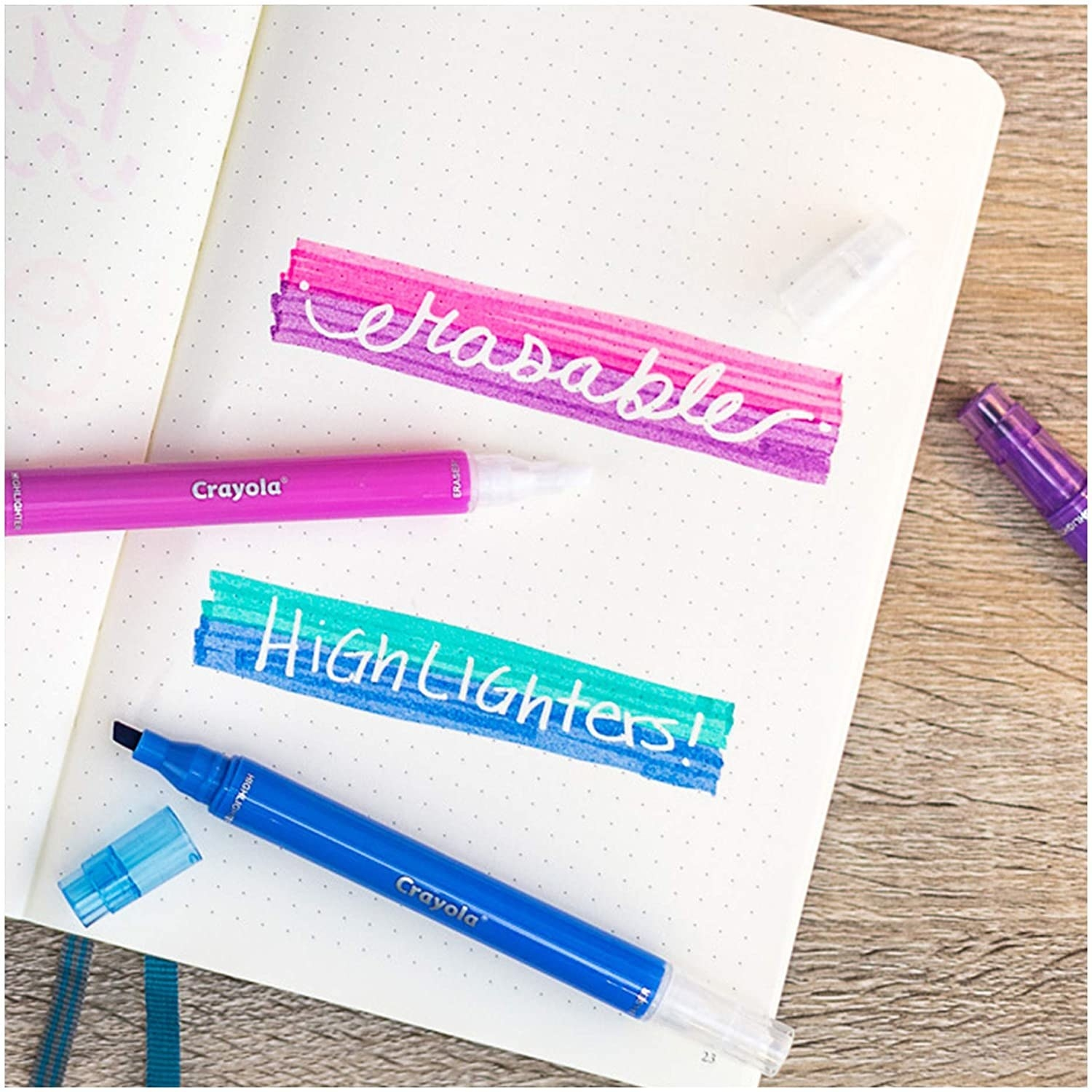 Two erasable highlighters on top of a bullet journal