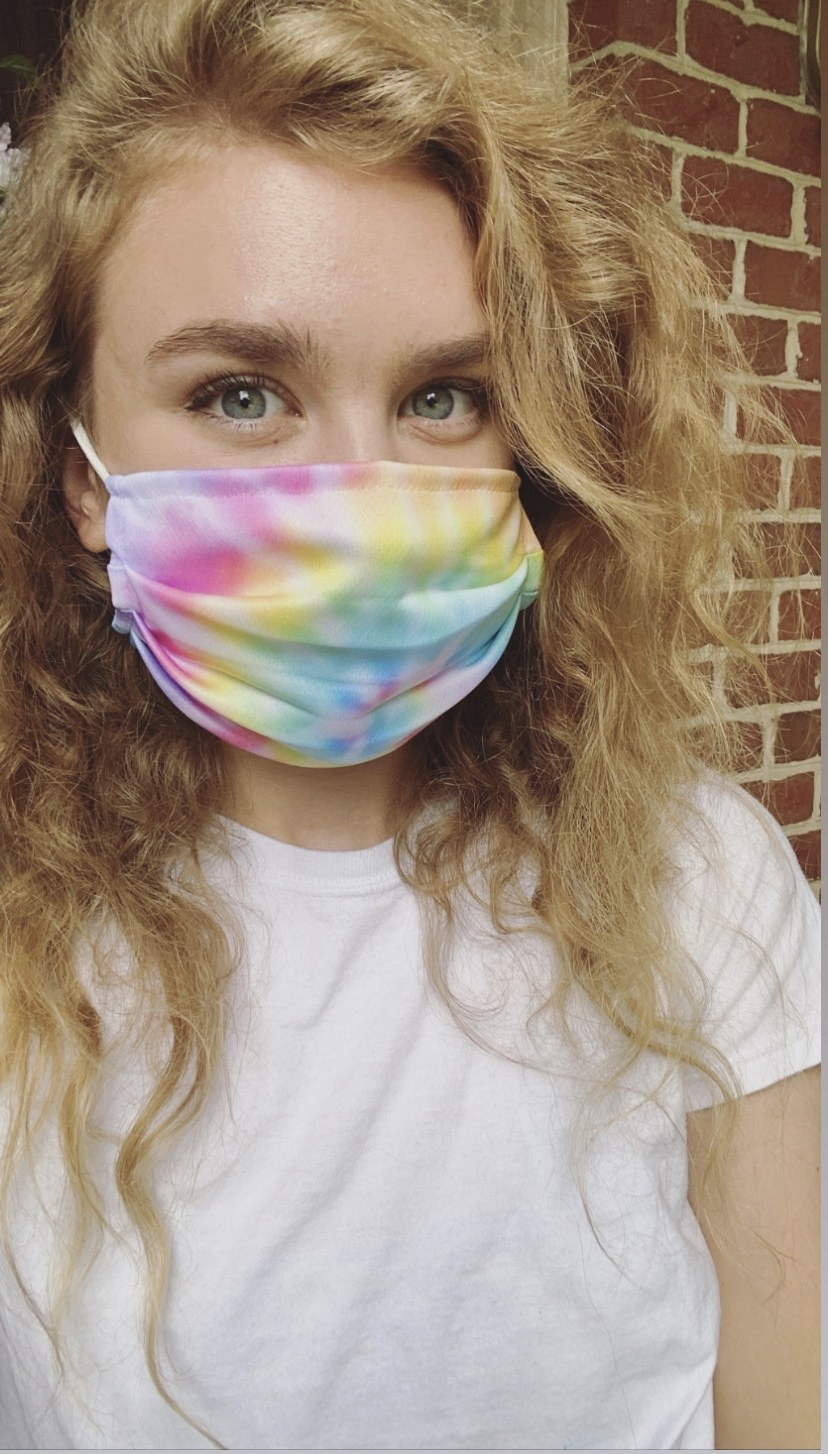 BuzzFeed editor in a rainbow tie dye face mask