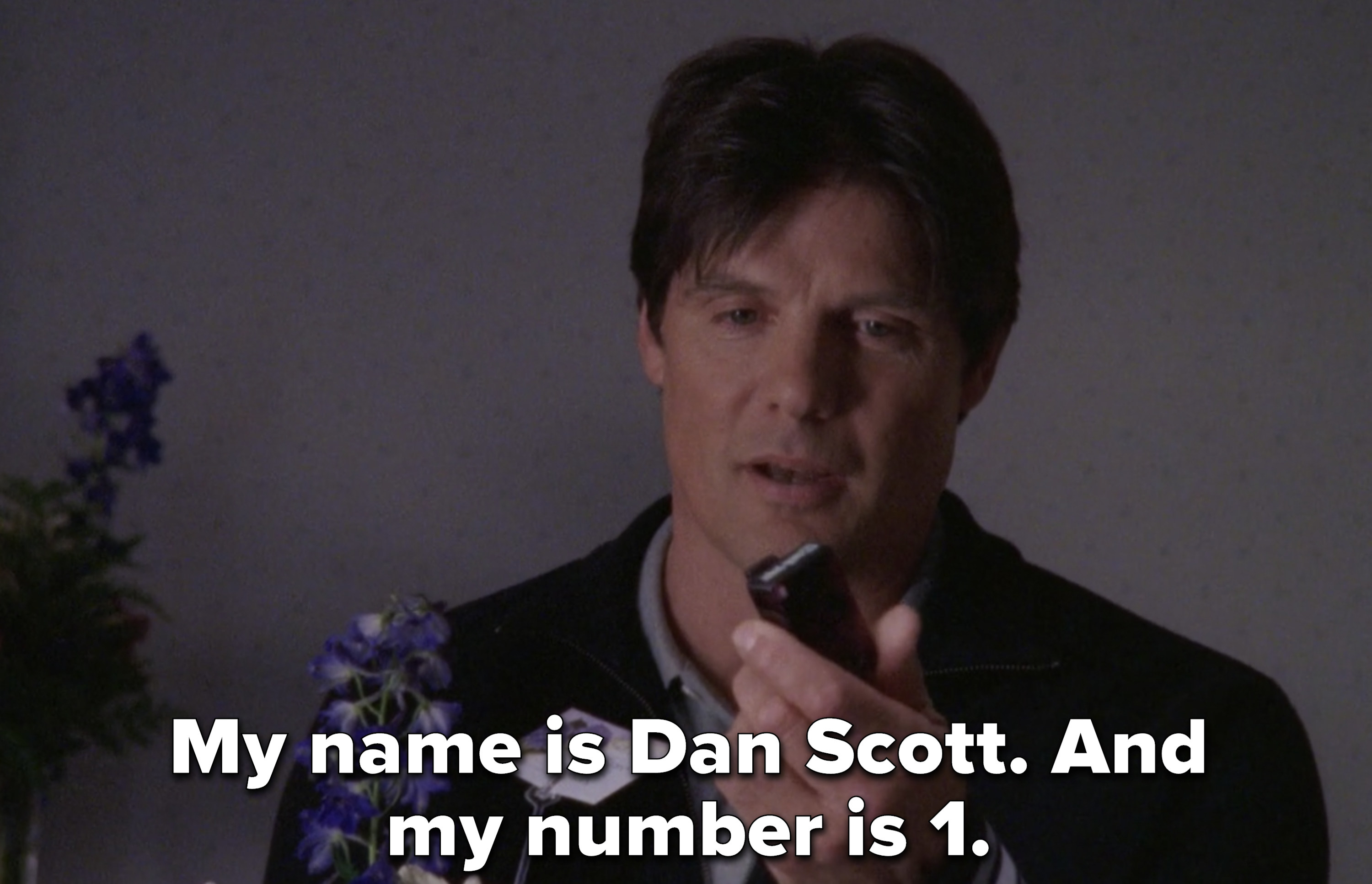 """Dan holding the beeper that tells him when his heart is ready saying """"My name is Dan Scott and my number is 1"""""""