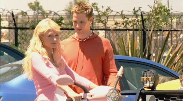 Caitlin on her scooter alongside Logan