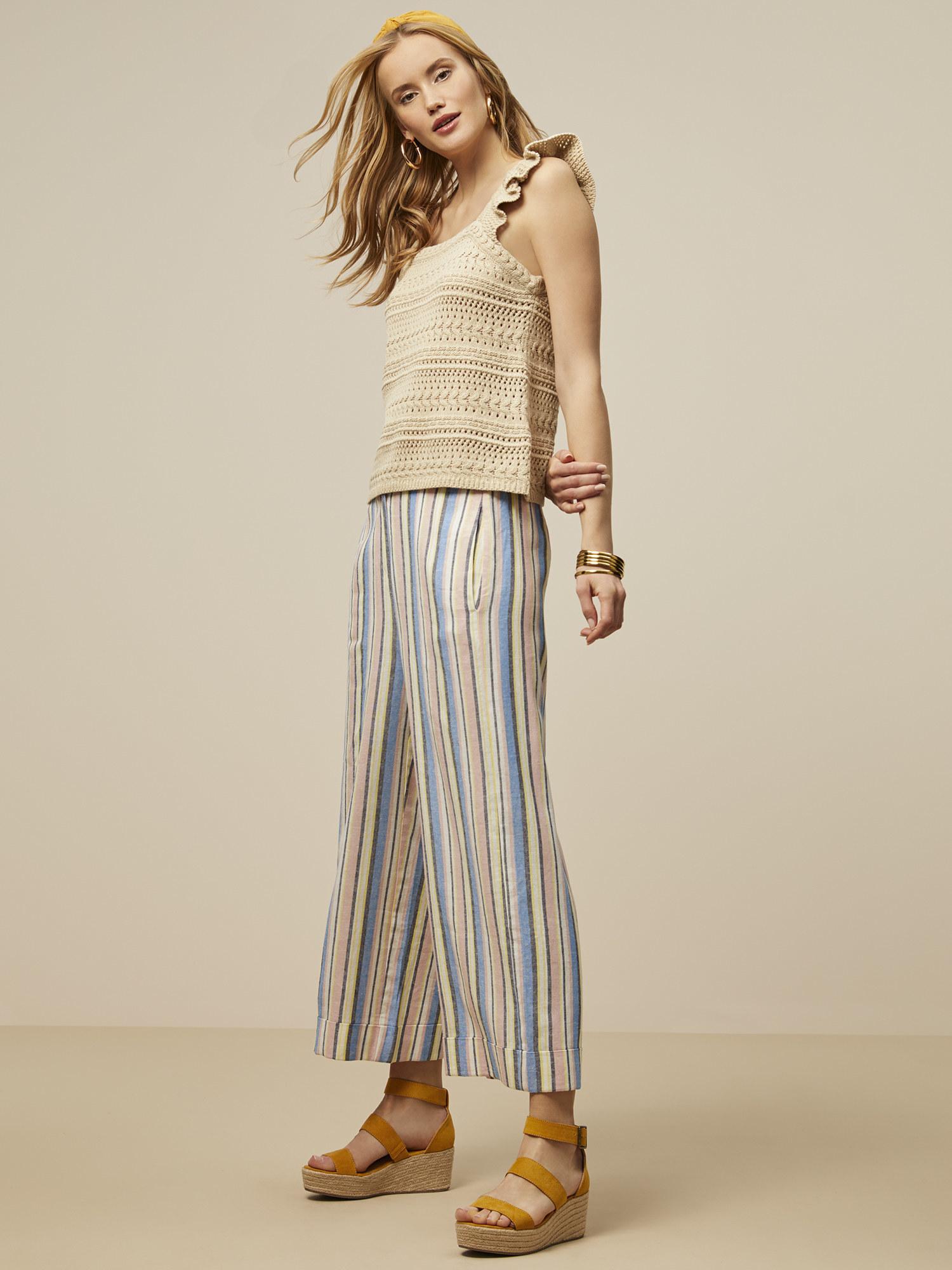 A model in striped linen pants