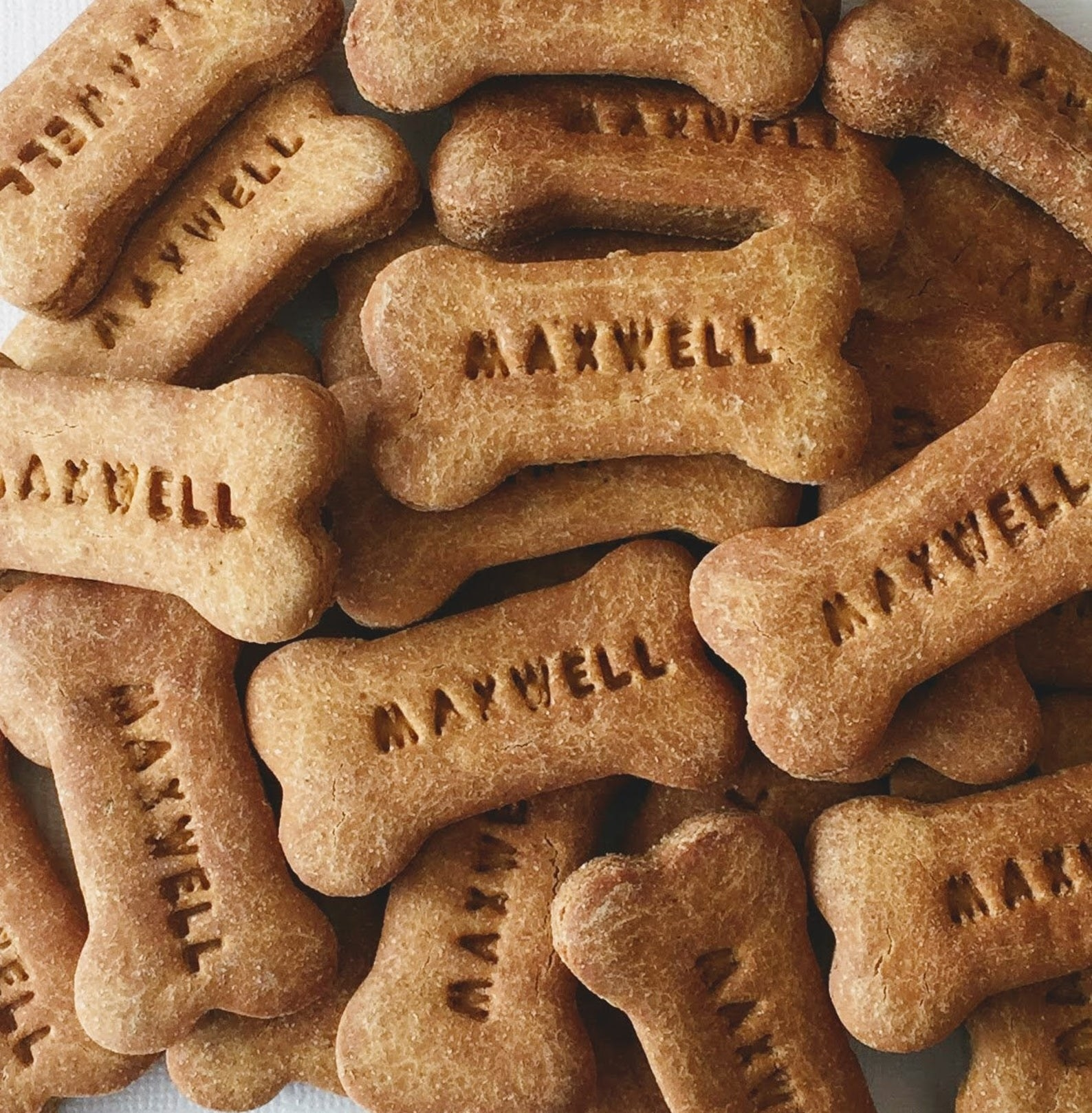 The dog bone-shaped treats with the dog's name printed on them