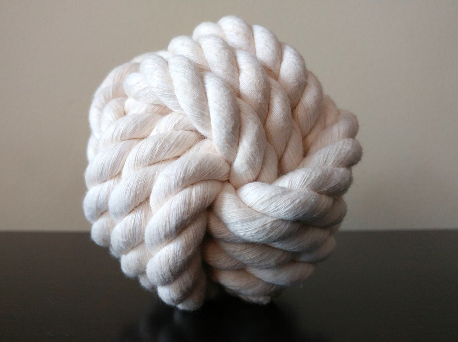 The braided rope toy in the shape of a ball