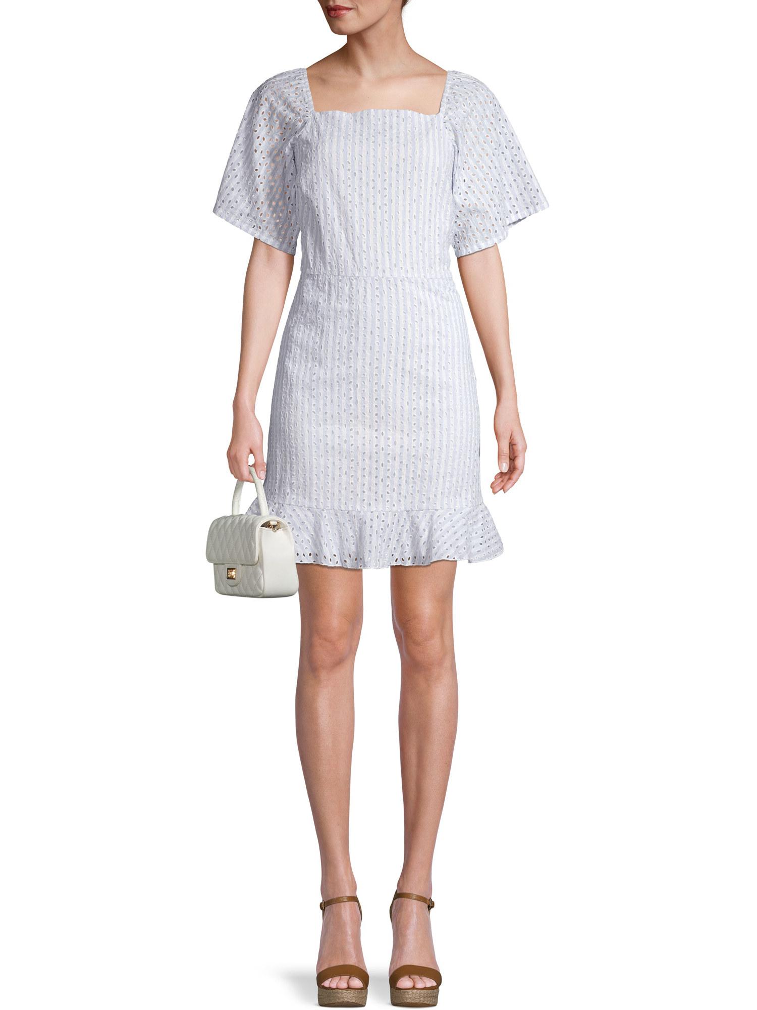 model in white eyelet dress with ruffled hem
