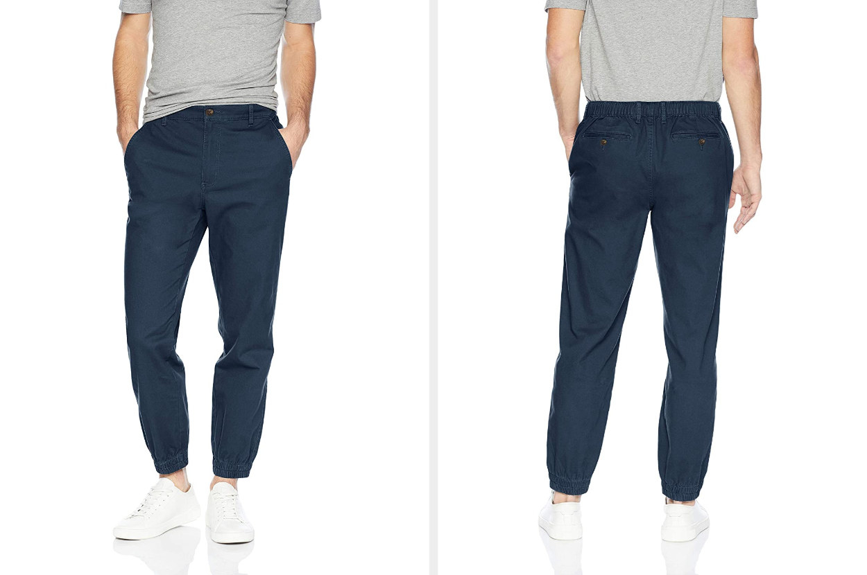 Side by side image of the front and back of a model wearing a navy blue joggers