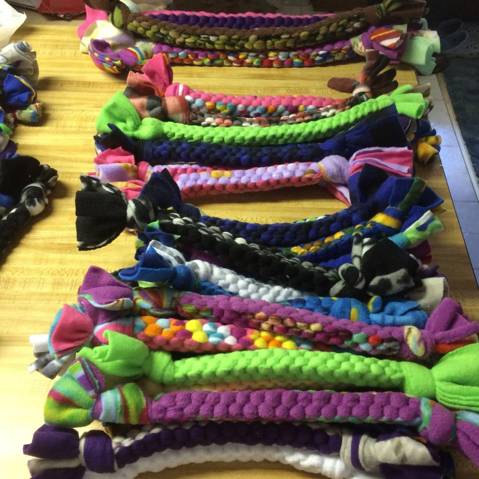 A pile of braided tug toys in assorted color combinations