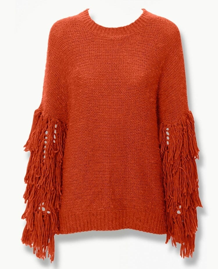 rust orange crewneck sweater with fringed sleeves starting at around the elbow and going to the wrist