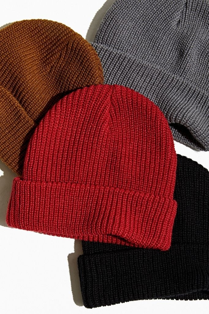 Red, black, brown, and charcoal beanies