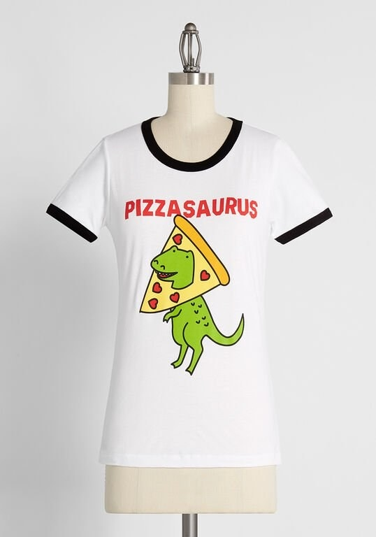 "The white T-shirt with black-lined sleeves and neckline featuring a green dinosaur whose head is sticking out through a piece of pizza and reads ""Pizzasaurus"""