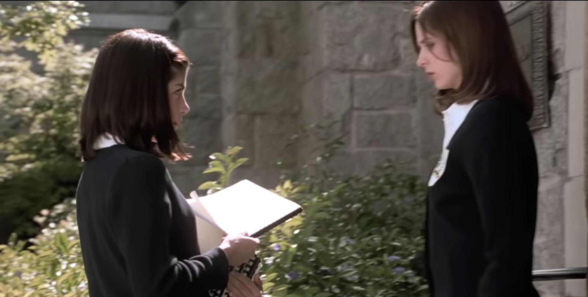 Cecile handing Kathryn a copy of Sebastian's damning journal.