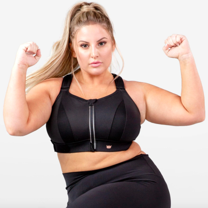 Model wears black Shefit Ultimate Sports Bra with adjustable straps and a zippered front