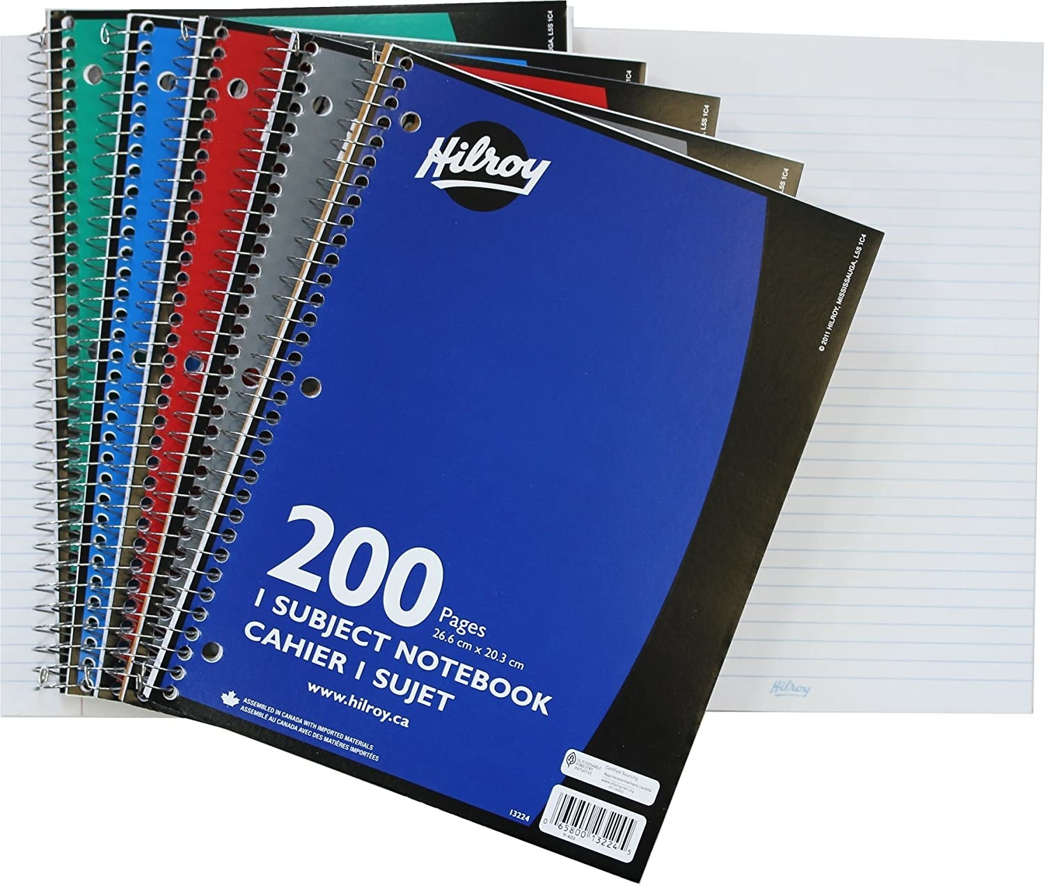 Notebooks stacked on top of each other with a wire binding