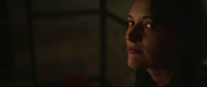 Fleabag (Phoebe Waller-Bridge) looking up at the camera/audience after breaking up with Hot Priest.