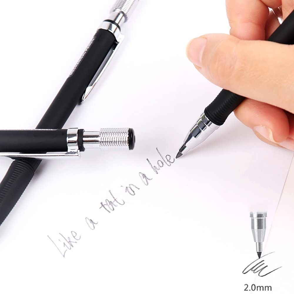 A hand writes while using the mechanical pencil