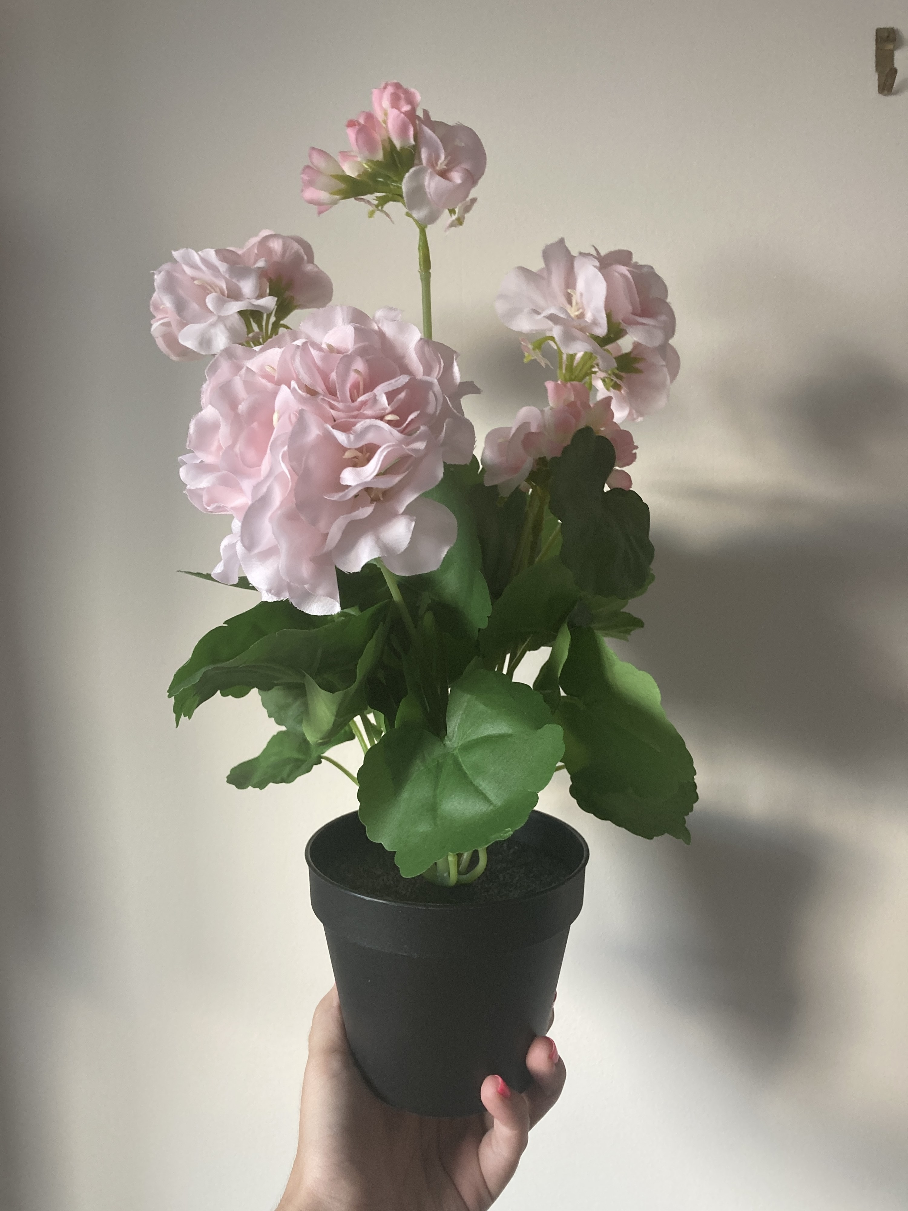A small pot of fake flowers