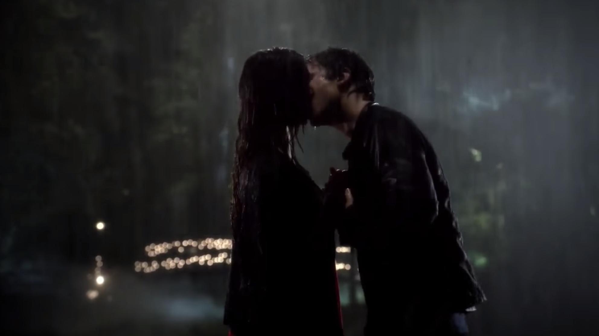 Elena and Damon kissing in the rain.