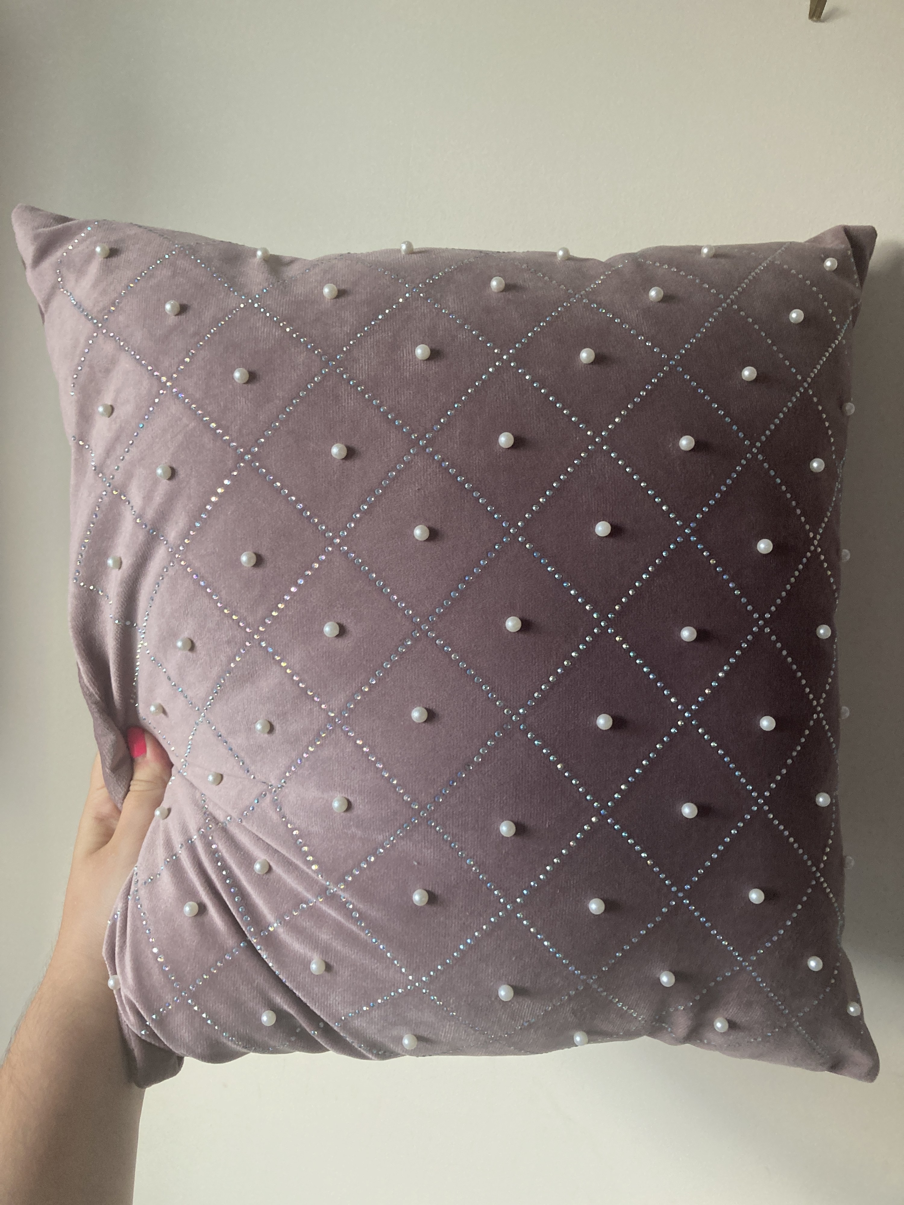 A pillow covered with little gems and fake pearls