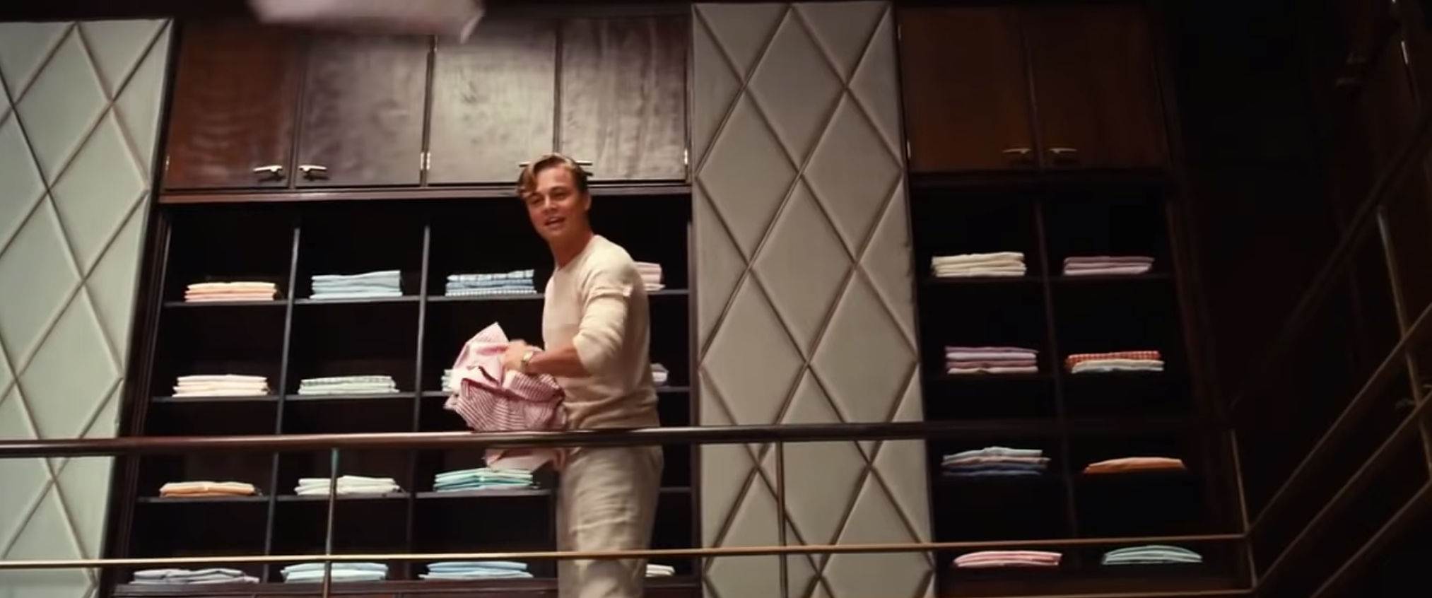Jay Gatsby throwing his fancy shirts from his closet into Daisy's arms below.