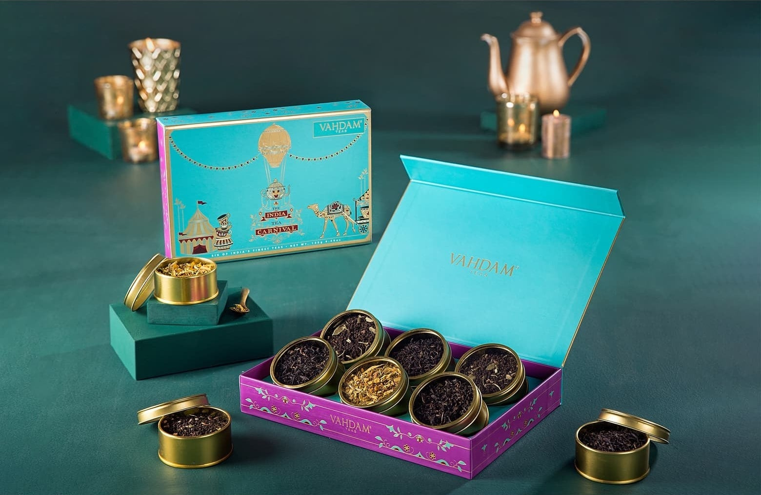 The six teas in small gold circular cans displayed in a box